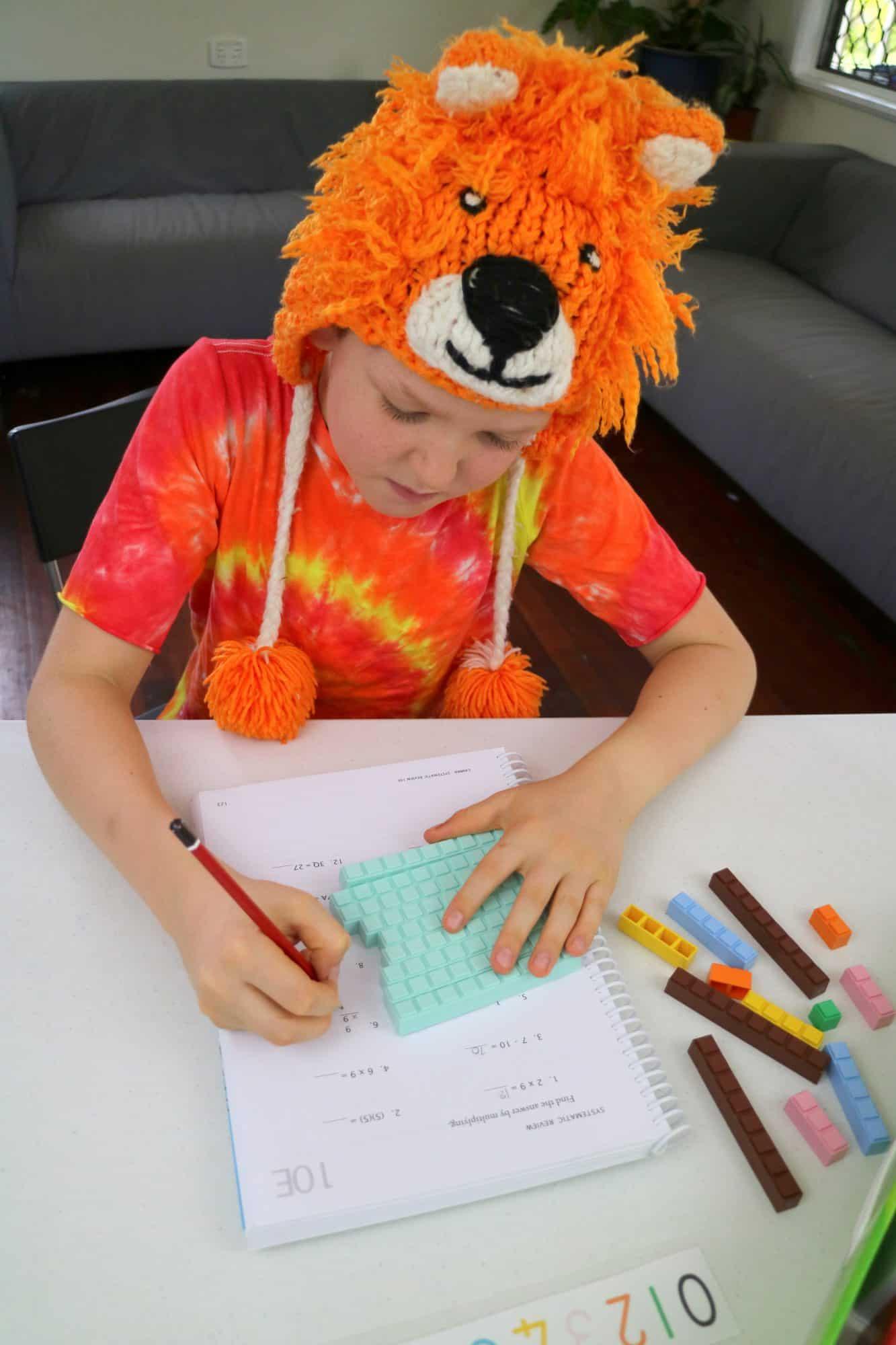 Forrest doing math-u-see worksheet